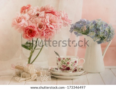 White lace,hydrangea,rose s and tea cup on pastel background,vintage style - stock photo