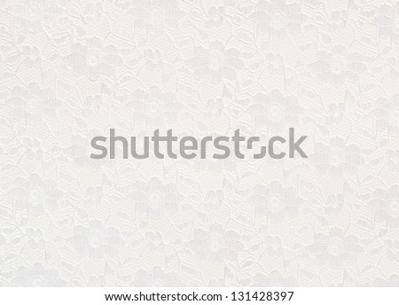 White lace with small flowers on the white background - stock photo