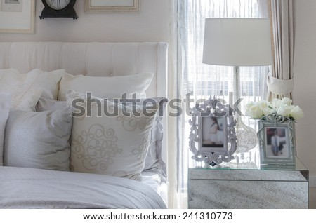 white lamp with picture frame on glass table in luxury bedroom - stock photo