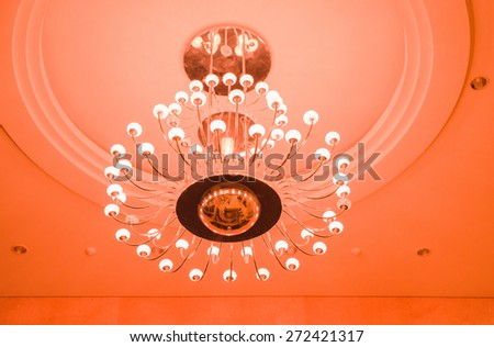 White lamps on brass structure with pink light - stock photo