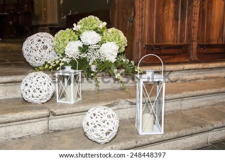 white lanterns and flowers on the pavement - wedding decoration - stock photo