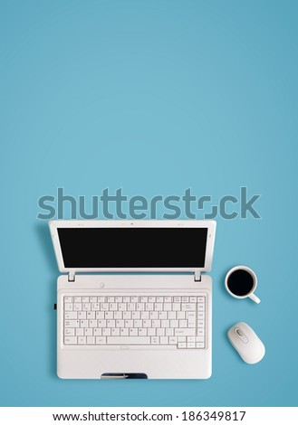 White laptop on table - place for text. - stock photo