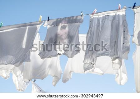 White laundry drying on a washing line - stock photo