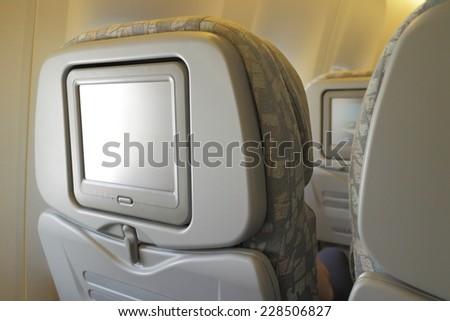 White LCD screen in an airplane seat, copy space for text or image - stock photo