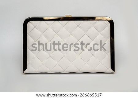 White leather clutch on a white background - stock photo