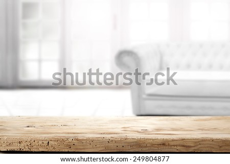 white leather sofa and desk of wood in brown color  - stock photo