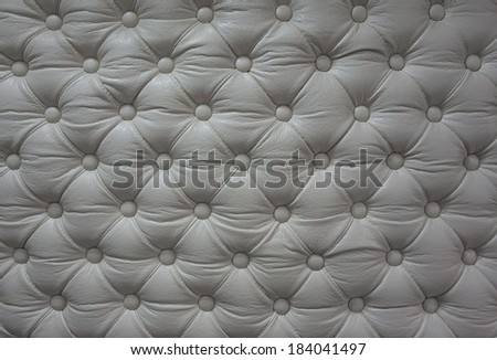 White leather texture. Closeup shot of sofa, chair or wall. - stock photo