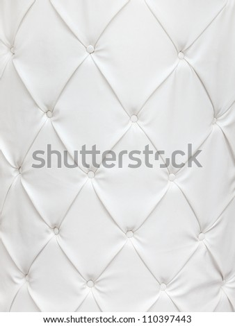 White leather texture with buttons in a pattern - stock photo