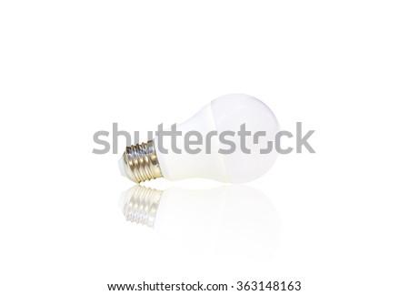 white LED light bulb isolated on white background with reflection - stock photo