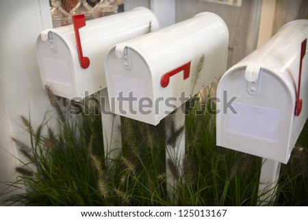 white letter boxes in seasonal garden - stock photo