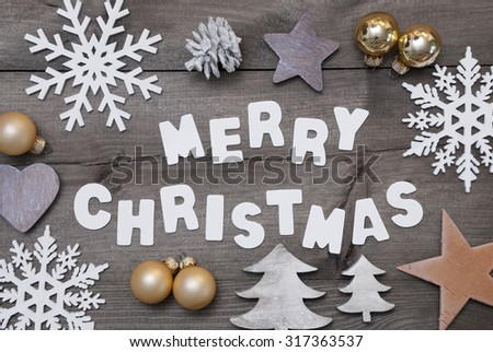White Letters With Word Merry Christmas On Brown Wooden Background. Christmas Greeting Card. Gray Rustic, Vintage Style. Christmas Decoration, Christmas Tree, Snowflakes,Golden Christmas Ball - stock photo