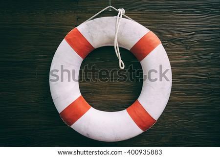 White Lifesaving Float on wood Background - stock photo