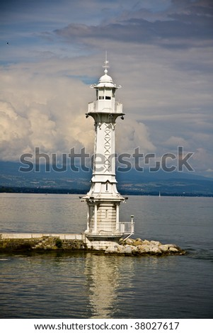 White lighthouse on the berth - stock photo