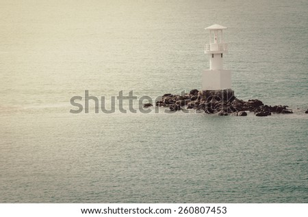 White Lighthouse on the sea and blue sky in Thailand vintage - stock photo