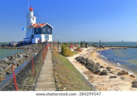 White lighthouse on the seashore in Marken, Netherlands  - stock photo