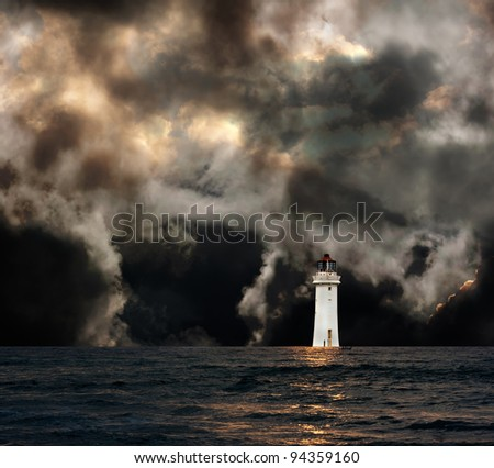 White lighthouse with dramatic storm clouds - stock photo