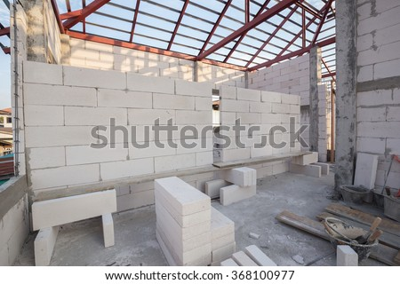 white Lightweight Concrete block, Foamed concrete block, raw material for industrial wall or house wall - stock photo