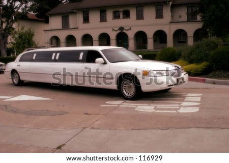 White limo at resort. - stock photo