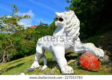 white lion at gunhill signal station, barbados - stock photo
