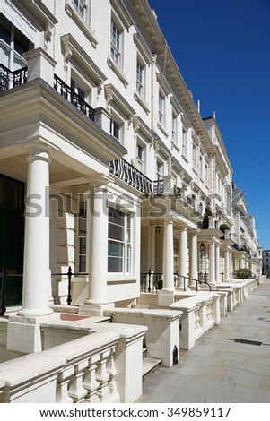 White luxury houses facades in London, borough of Kensington and Chelsea - stock photo
