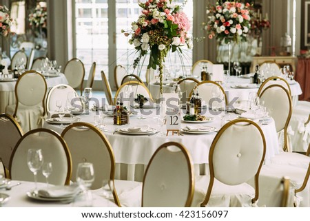 White luxury round table for the guests - stock photo