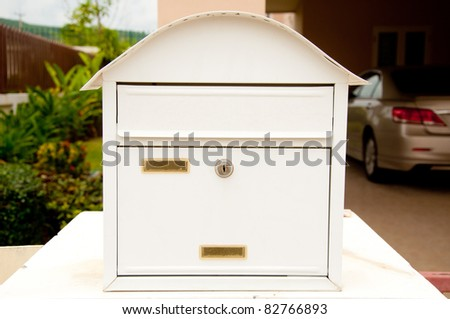 white mail box in front of home - stock photo
