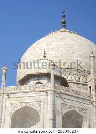White marble details of the Taj Mahal mausoleum in Agra, India, with cupola and arches - stock photo