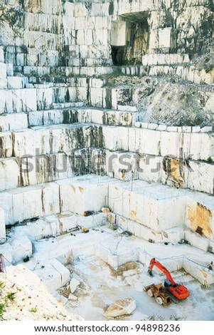 White marble quarry with excavators. Carrara, Tuscany, Italy - stock photo