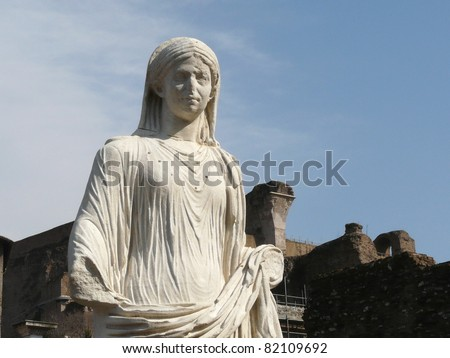 White marble statue of a woman at the Temple of the Vestal Virgins in Roman Forum in Rome, Italy - stock photo