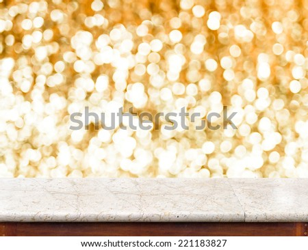 White marble Table with bokeh golden sparkling background,Empty room for display your product - stock photo