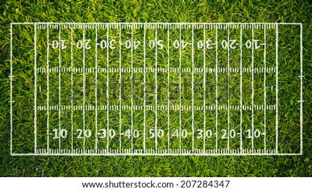 White markings of an American football stadium over green grass. - stock photo