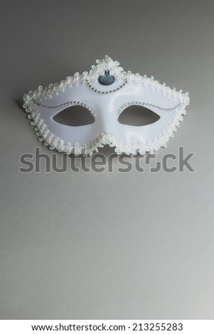 White mask on a gray background with copy space - stock photo