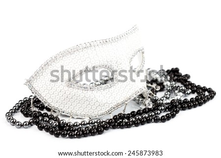 White mask with shiny pearls, black and white shot - stock photo