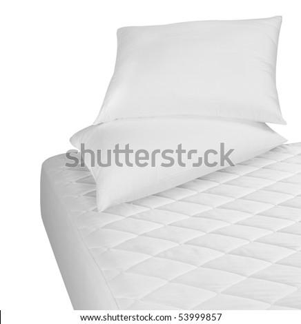 White mattress and pillows over white. - stock photo