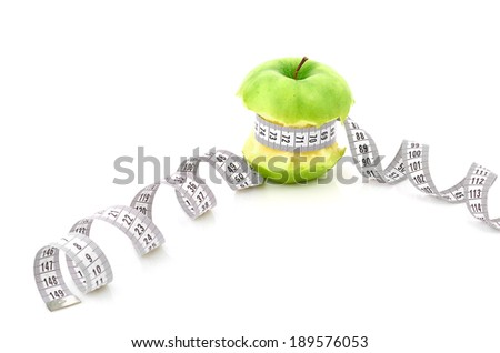 white measuring tape and apple - stock photo