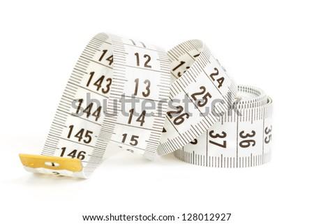 White measuring tape isolated on white background - stock photo