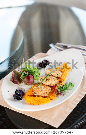 White meat patty cakes with pumpkin mash, copy space - stock photo