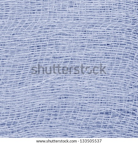 White medical bandage gauze texture, abstract textured background macro closeup, natural cotton linen fabric, copy space in blue - stock photo