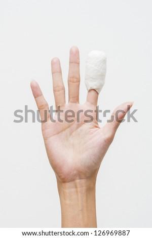 White medicine bandage on human injury hand finger - stock photo