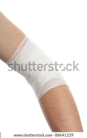 white medicine bandage on injury elbow on white background - stock photo