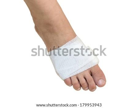 White medicine bandage on injury foot with white background, isolate - stock photo