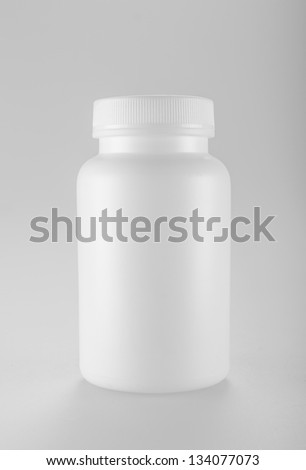 White medicine bottle on white background - stock photo