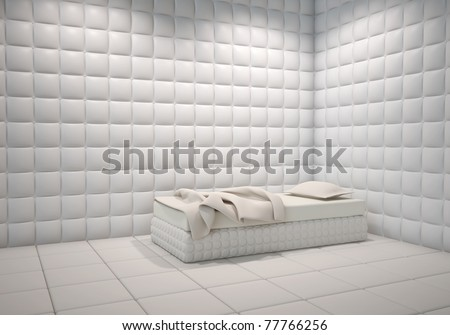white mental hospital padded room corner with a bed - stock photo