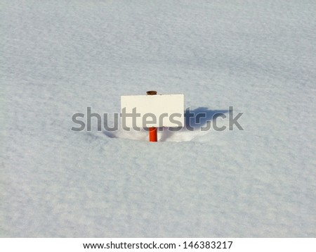 white metal signboard in snow background - stock photo