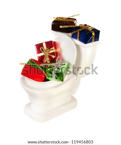 White miniature toilet pot filled with gifts and presents - stock photo