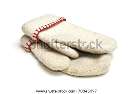 White mittens with red thread over white background - stock photo