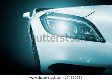 White modern car closeup of headlight. Exterior detail, shallow depth of field. - stock photo