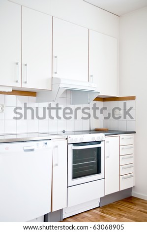White modern kitchen design is extremely stylish and wood-flor. - stock photo