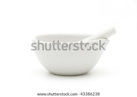 White mortar and pestle over white background - stock photo
