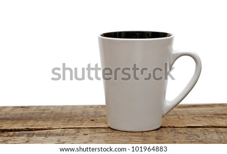 White mug empty blank for coffee  on a wooden table over white background - stock photo